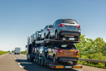 car carrier loaded with brand new cars