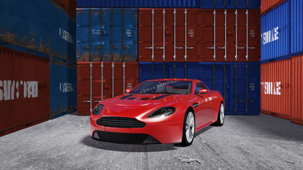 A sports car in front of shipping containers.